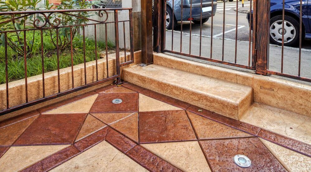 An image of a patio with stamped and colored concrete made by concreting Ipswich