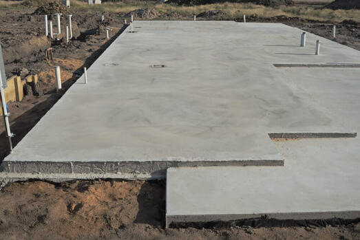 concreting Ipswich's freshly dried concrete house slab with pipes sticking up
