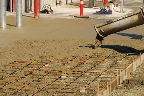 Concrete slab being poured with a concreting Ipswich truck