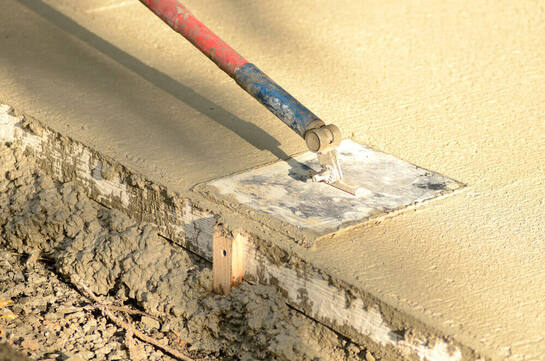 Close up of concreting Ipswich's extendable trowel finishing off a concrete pad